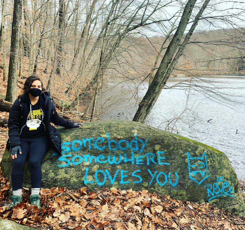 "Me & a rock that says ""Somebody somewhere loves you"""